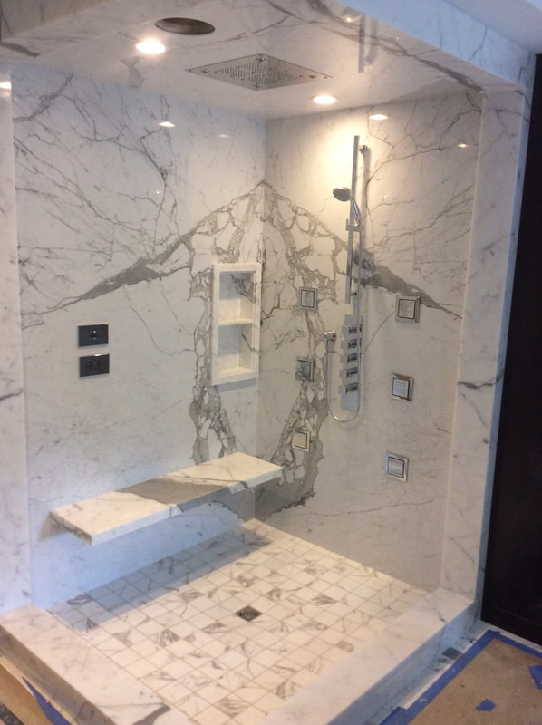 Contemporary Calacatta Marble Shower with bench and inset shelves made from Designer Stone Panels Thin Sheets.