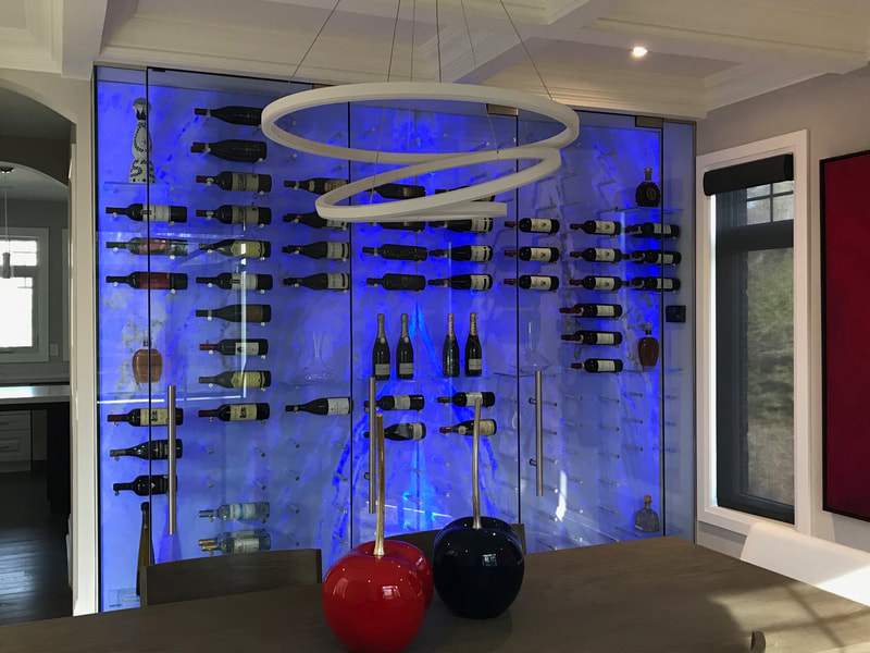 Contemporary Wine Cellar made with RGBW backlit Onyx panels. Color showing is blue. Onyx is DSP Thin Island blue Onyx